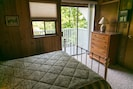 Bedroom #3 with queen bed and balcony with views of the lake.