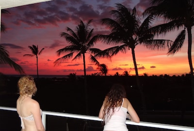 Our girls enjoying another spectacular sunset from the lanai