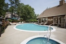 Outdoor pool with furnished sundeck.