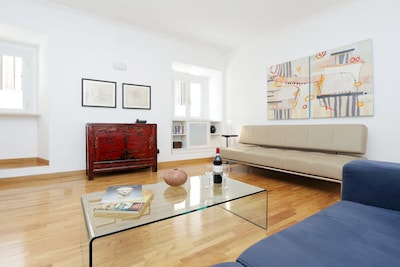 Living room - spacious and light, with modern furniture and beautiful artwork.