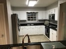 Stainless appliances and granite counters for your favorite beach meals