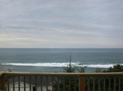 Ocean view from the middle of our front deck.  Sit in the deck chairs and RELAX!