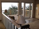 View from the dining room looking at the main entrance and part of the deck.