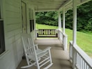 Swing on the porch or rock in a chair; enjoy the gentle sounds of the creek.
