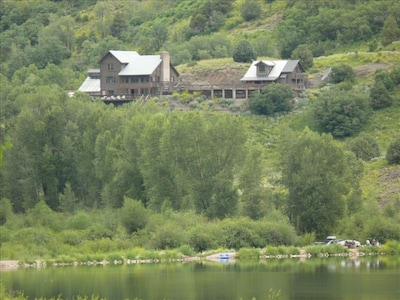 Marble Lodge on Beaver Lake Retreat campus viewed from Beaver Lake in Marble.