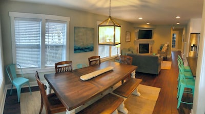 Open floor plan with seating for 10 at the reclaimed wood farmhouse table