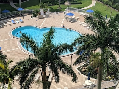 View of the pool during the day from the balcony.