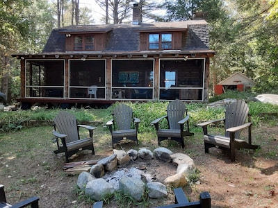 Front porch and fire pit overlooking the lake
