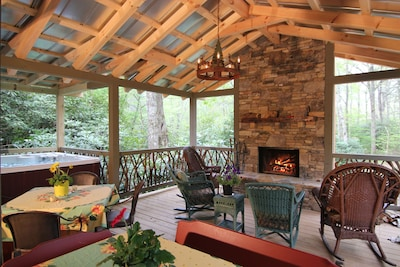 Outdoor Entertainment Area With Spa, Stone Fireplace and Dining