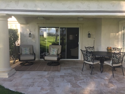 Updated patio surface and furniture