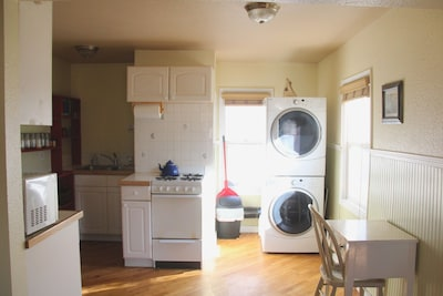 Darling kitchen with gas stove, washer/dryer, desk