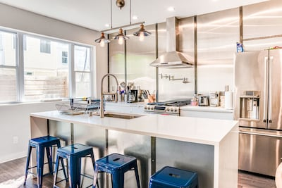 Fully stocked chef's kitchen with 8' island and 4 barstools