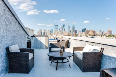 Large rooftop deck with amazing city views and plenty of seating.