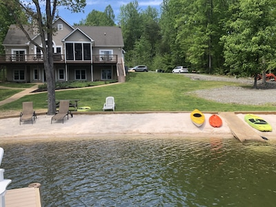 View of the house and beach from the dock.
