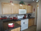 Kitchen is fully equipped, including a microwave, dishwasher and coffee maker