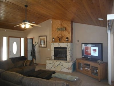 Living room with gas fireplace, internet tv with Netflix.