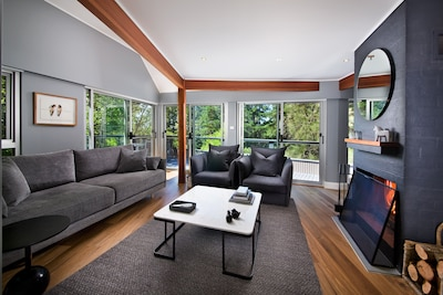 Relax in the spacious, yet warm living room with open fire place