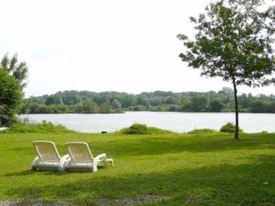 Jardin avec vue directe lac