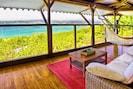 salon extérieur avec hamac, vue mer