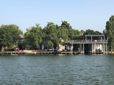 view from lake.  175 feet of waterfront.  outdoor spaces and protected swim area