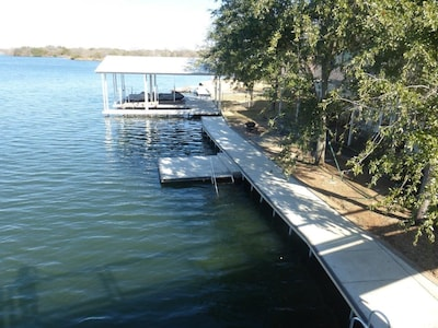 LED lit boardwalk with swim deck and stairs that go into water.  Great for pets