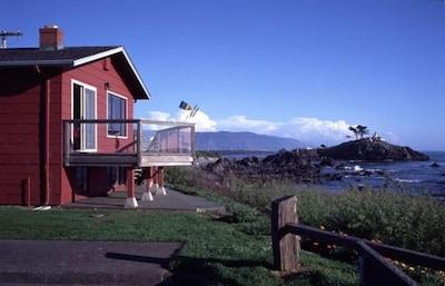 Beach House and Light House as seen from near the beach access