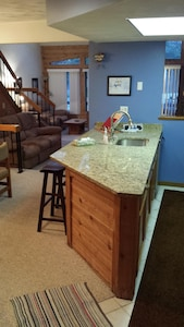 new granite counter tops in the kitchen