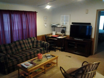 Upstairs Unit Living Area. This room also has a loveseat that is out of view.