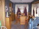 Upstairs Unit Dining Rm & front entrance/sunroom with additional table & chairs
