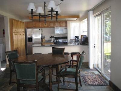 Stocked Kitchen with Granite, Wine fridge, slate floor, 8 seat round table