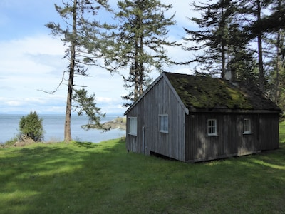 Lighthouse Keeper's cottage, low bank beach in front, and East Point Park beside