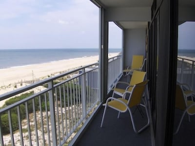 Oceanfront balcony with loungers, seating, cafe table and breathtaking view!