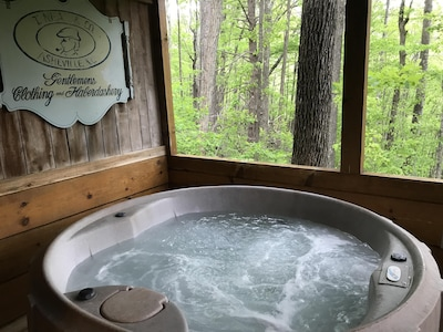 secluded hot tub with a forest view