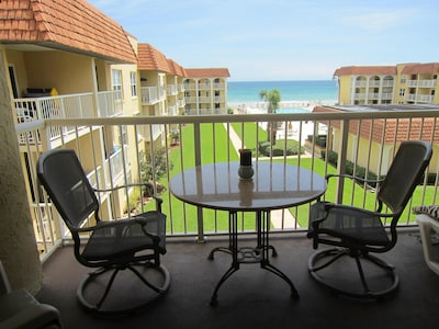 Enjoy meals on balcony with room for four plus lounge chair for reading/relaxing