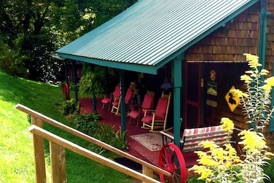Welcome to your Creek-side Rustic Cedar Cabin by quiet country road