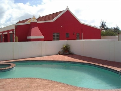 House next to the shared pool
