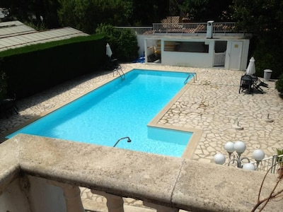 Gated pool in the apartment building with barbecue