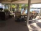 Lanai has a sofa, two rockers, granite table that seats 6, and a great view!