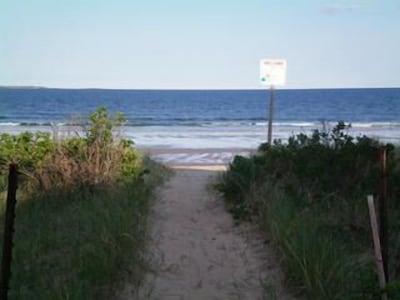 Walkway around the corner to the beach !