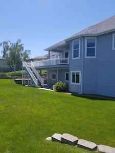 Back of the house.  Entertaining deck above, patio below and lots of lawn space.