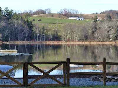 View from lawn. Dock at left, fire pit at right, float left-center