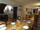 Dining area with wood burning fire with view to the kitchen. Plenty of space!