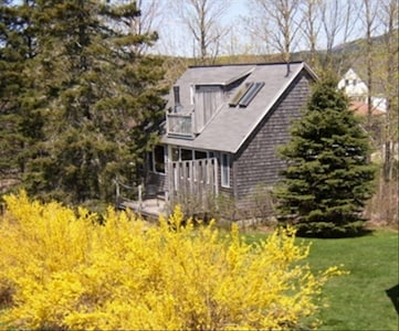 The Carriage House with the Mountains of Acadia in the Background