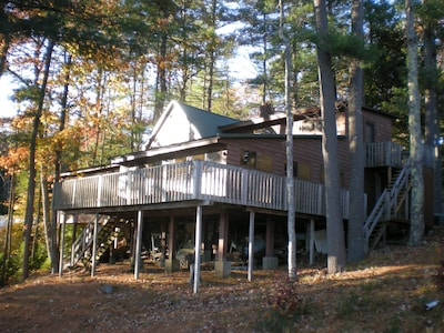 Huge lakeside cottage with roomy wrap around outdoor deck.