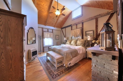 Master bedroom, king bed, flat screen TV, and fireplace.