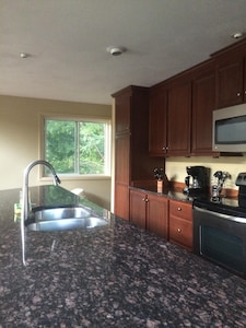 Granite countertops , stainless appliances,  All amenities of home