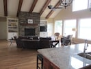 """Huge vaulted ceiling Family Room; 50"""" stacked stone fireplace & """"wall of windows"""""""