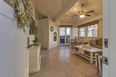 Living room showing door to porch