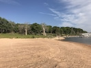 Red Sand Beach with shallow water sand bar for swimming.  Great for kids!