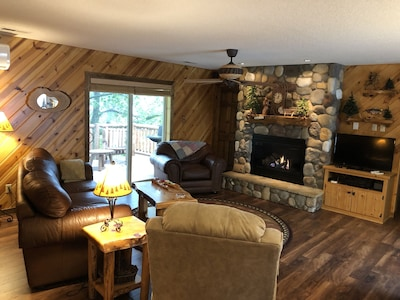 Cozy seating area with gas fireplace and TV